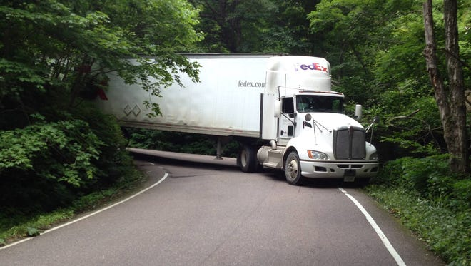 A tractor trailer blocks Vermont 108 through Smugglers Notch between Jeffersonville and Stowe in July 2014.