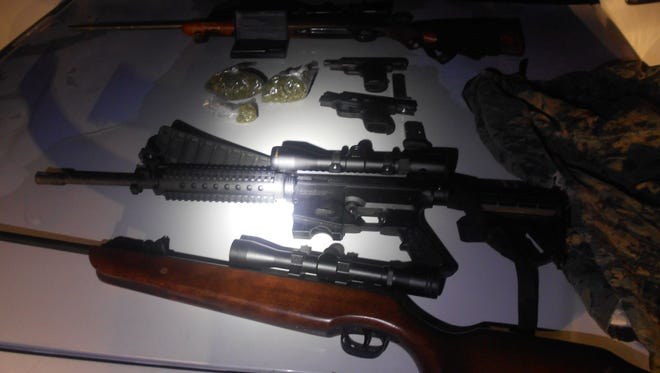 Guns and drugs found during arrest.