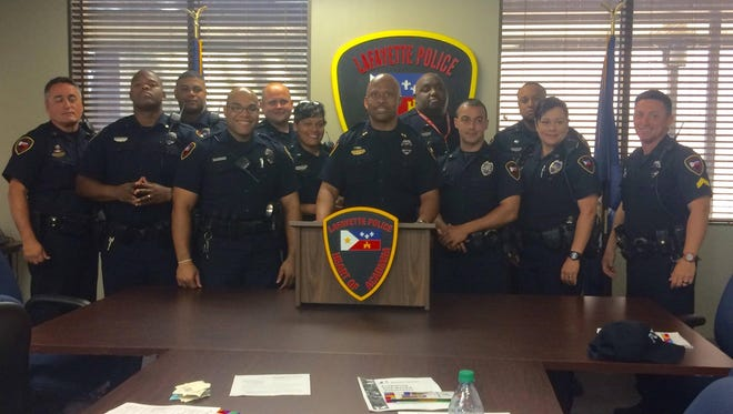 Lafayette Police Chief Reginald Thomas and the 11 school resource officers participating in the Bigs in Blue program