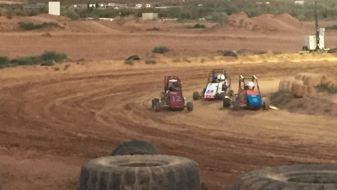 Racers come out of a turn at Mesquite Motorcross Park on Saturday at the Las Vegas Quarter Midget racing series.