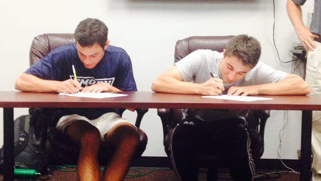 Asheville High seniors Will Jones (Emory, Ga.) and Massi Tager (Emory & Henry, Va.) have signed to play college soccer.