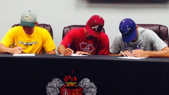 Asheville High seniors Jared Patterson, Noah Cook and Langston Haden signed to play college baseball on Wednesday.