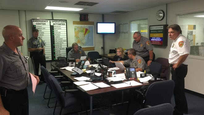 Because of the presence of the Oyster Creek nuclear power plant in Lacey, Ocean County authorities train regularly on how to respond to a release of radiation into the atmosphere. Officers from the Ocean County Sheriff's Office are seen here last fall in the county Office of Emergency Management at Robert J. Miller Airpark in Berkeley.