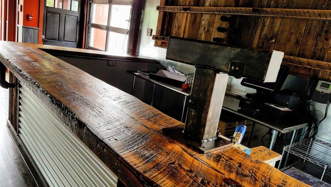 The reclaimed wood bar at Buns-N-Bourbon in Peekskill.