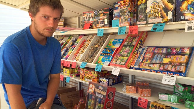 Clay Hancock operates the Mr. W fireworks stand at the corner of Pearl and Pine streets.