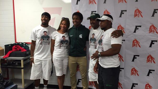 The Scott family (L to R) Joshua Scott, Danielle Scott, Josiah Scott, Oliver Scott and Elijah Scott pose for a photo following Josiah's commitment to Michigan State.