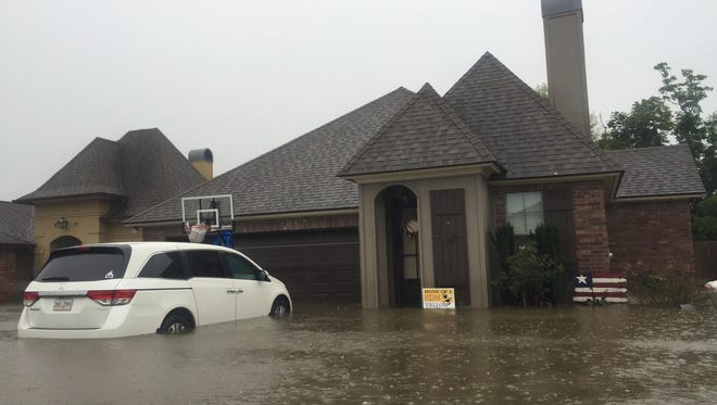 A home in the Sawgrass subdivision near Milton is flooded.