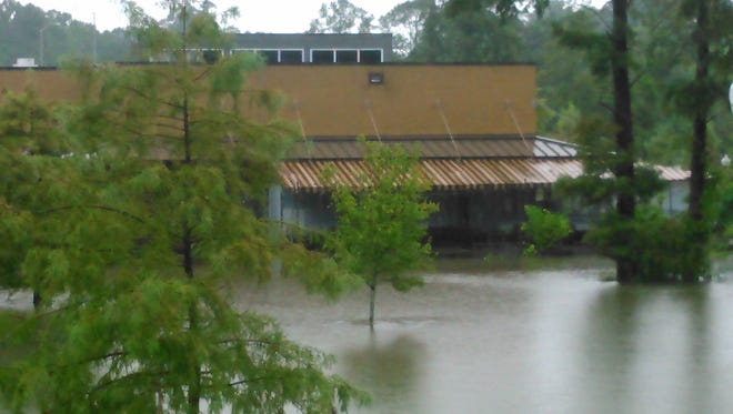 The parking lot of Ruffino's on the River is completely submerged.