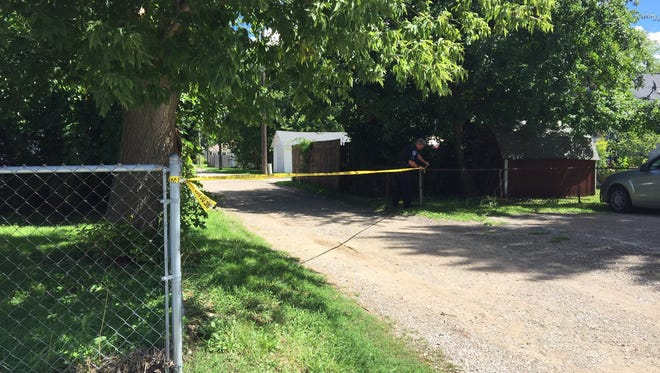 Police tape off a crime scene near Griswold and 20th streets in Port Huron Thursday.