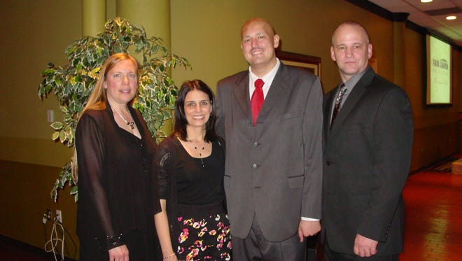Sherri Roberts (from left), Amanda Milner, Cody and Todd Roberts attended a Fair Haven dinner/auction in 2012.