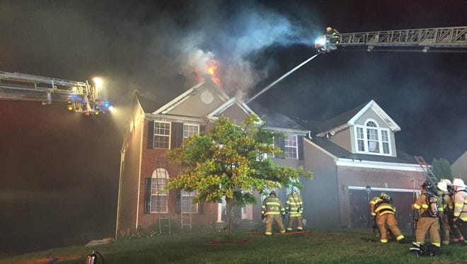 Firefighters battled a blaze in Windsor Township. Flames were shooting through the home's roof.