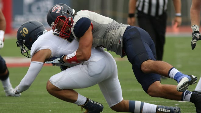 Richard Nase wraps up Clarion quarterback Connor Simmons for a sack last Saturday during Shippensburg's 41-17 victory.