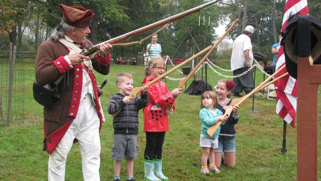 Children conducting a musket drill with wood muskets at the Lord Stirling 1770s Festival at the Environmental Education Center in Basking Ridge.