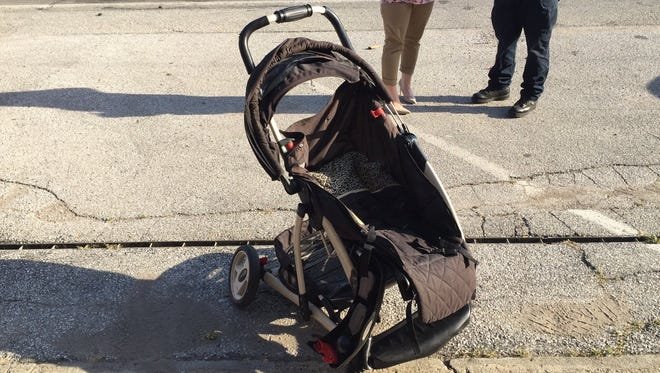 A woman and her grandchild were struck by a car Wednesday evening, knocking the toddler out of a stroller. The toddler was taken to Riley Children's Hospital.