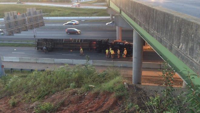 An overturned tractor trailer blocks lanes of I-85. Thursday, Sept. 29, 2016