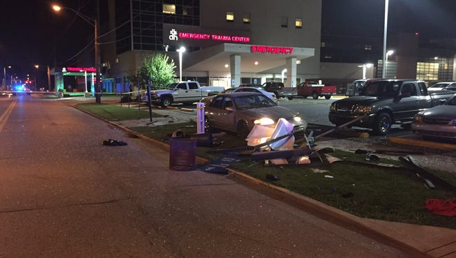 A 1997 Toyota Camry struck the bus stop outside of Deaconess Hospital on Tuesday evening. Two people inside the structure were injured, and the driver is now facing intoxicated driving charges.