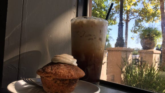 The pumpkin muffin and fall-spiced NOLA iced coffee are pictured at The Lab Handcrafted Coffees and Comforts.