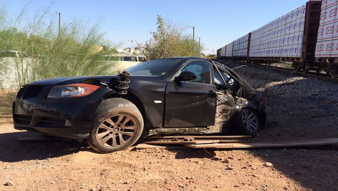 A car that was hit in train collision near the intersection of Cooper and Guadalupe Road in Gilbert on Oct. 20, 2016.