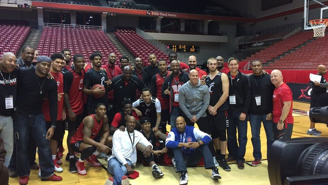 Current and former University of Cincinnati basketball players gather with coach Mick Cronin (far right) after Saturday's scrimmage.