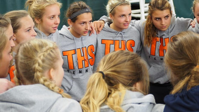 Tech players gather Wednesday during action at the Class 2A state girls tennis tournament at Baseline Tennis Center in Minneapolis.