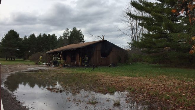 A garage at Holy Trinity Monastery was damaged in a fire Monday afternoon.