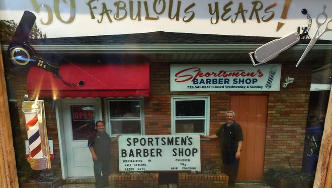Sportmen's Barber Shop in Carteret celebrated its 50th anniversary on Halloween. Pictured are owner Joe Caliguari, left, and barber Frank Stellato.