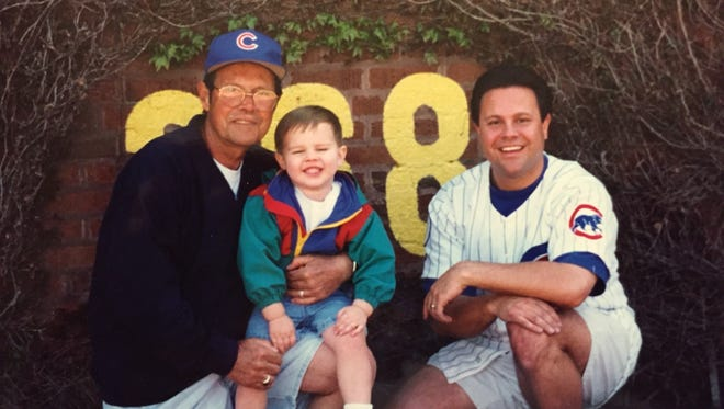 From left, Don Mammoser, Phillip Mammoser and Mike Mammoser at Wrigley Field in the 1990s. Don passed away in May 2016; Phillip is now a student at Murray State University and Mike Mammoser still lives and dies with the Cubs.