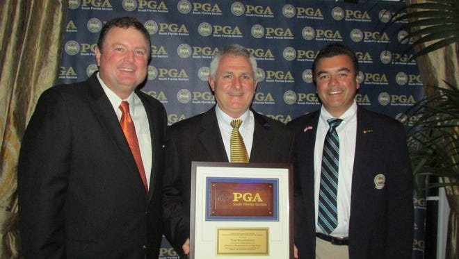 Olde Florida Golf Club director of golf Tom Wildenhaus, center, poses after being named the 2016 Golf Professional of the Year by the South Florida PGA Section on Tuesday, Nov. 15, 2016, at Grey Oaks Country Club in Naples, Fla.