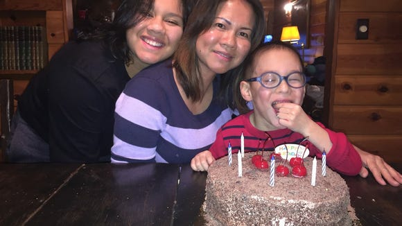 Cat Lee (center) has a new lease on life as she cares for her 17-year-old daughter, Mia, and 6-year-old son, Jacob.