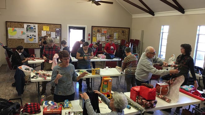 Volunteers donate a Saturday to wrap gifts for local families in need.