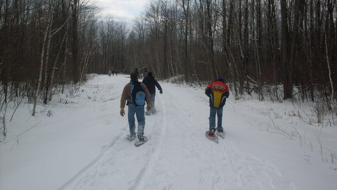 Snowshoe hikers get some physical activity in Marathon County.