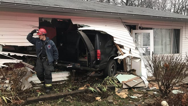 Officials are investigating after a man drove a black SUV into a northwest-side home on Jan. 11, 2017.