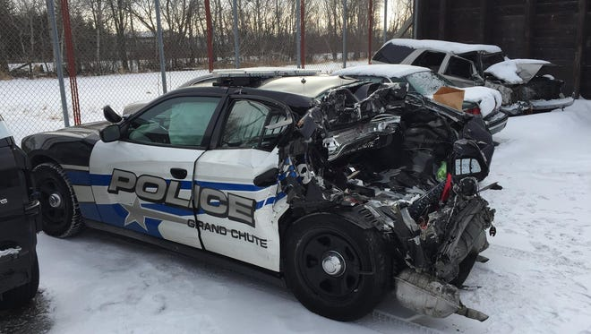 An unoccupied Grand Chute police car was struck as authorities investigated a two-vehicle rollover crash early Saturday morning.