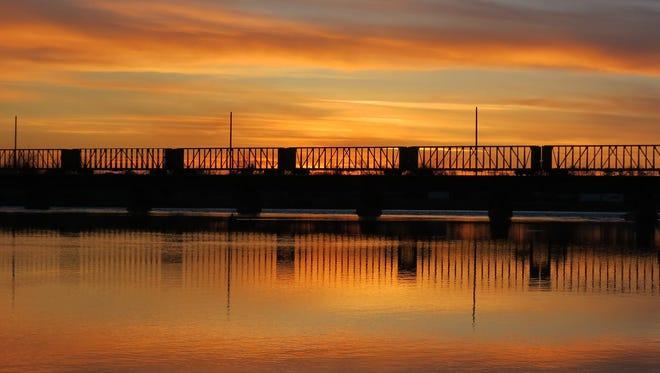 A train rolls over a bridge on the Missouri River.