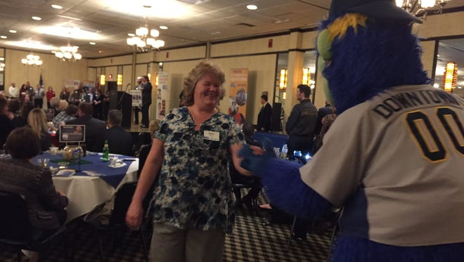 Downtown gives a high five to a prize winner during the United Way of York County's annual victory celebration.