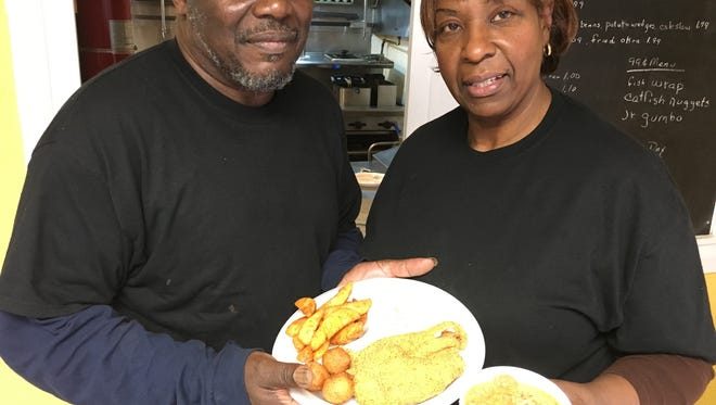 Gerald and Rogerline Long show off their catfish and gumbo specialties in New Providence.