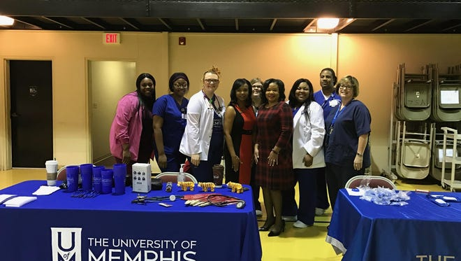 Mission Medical Ministry with New. St Luke Baptist Church members with University of Memphis nursing students at the Go Red for Women event at New. St Luke's on Sunday.
