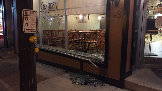The facade of Christine's Cafe was damaged in a crash that claimed the life of a man.