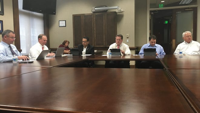 The county budget committee convened Wednesday. Shown from left are Mayor Jim Durrett and his chief of staff, Jeff Truitt, and committee members Tommy Vallejos, John Gannon, Larry Rocconi and Charlie Keene. Shelly Baggett is shown recording the meeting in the background.