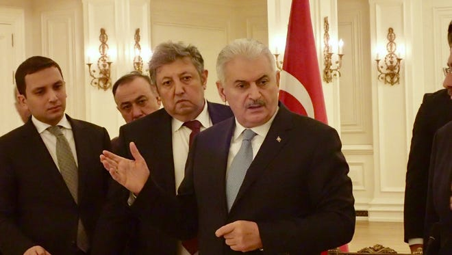 Turkish Prime Minister Binali Yildirim is seen with aides as he spoke at a luncheon with U.S. reporters at Cankaya Palace, his executive office building, in Ankara, Turkey, on March 9, 2017.