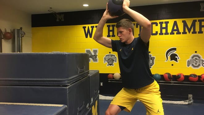 Michigan center Moe Wagner works out with a weight ball in Ann Arbor.
