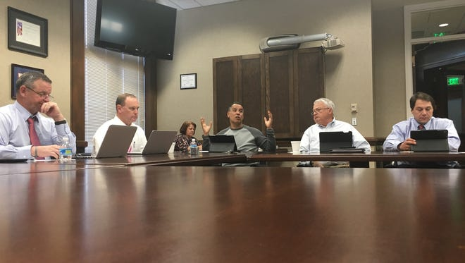 Commissioner Tommy Vallejos, center, emphasizes his point about local spending with County Mayor Jim Durrett, left, and fellow county Budget Committee members.