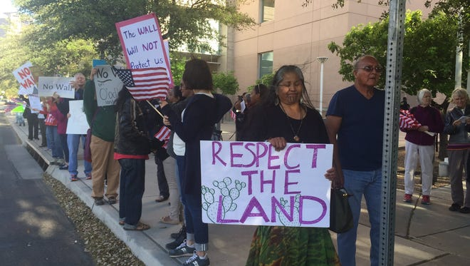 Thomasa Rivas (front) and other members of the Tohono O'odham Nation protest in March 2017 outside the Tucson offices of Sen. John McCain. The protesters want McCain to prevent a border wall with Mexico from crossing tribal lands.
