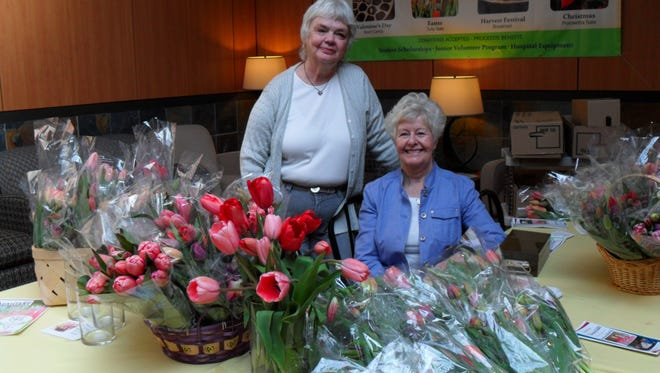 Sandra Zolkoske (left) and Leslie Bullock are ready for customers at a Santiam Hospital Auxiliary Easter tulip sale
