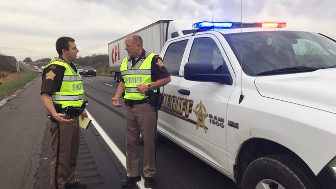 Warrick County sheriff deputies work the scene of a fatal accident Thursday morning.