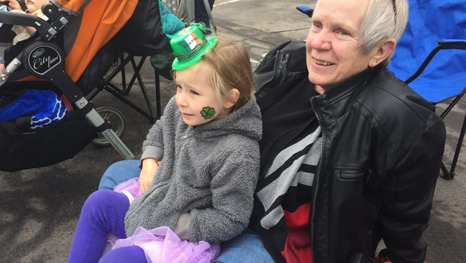 Donna Rose enjoys the Fort Collins' Saint Patrick's Day Parade with her granddaughter. Photo courtesy of Donna Rose.