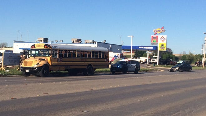 A car collided with an AISD school bus on Industrial Boulevard Wednesday morning, April 5, 2017.