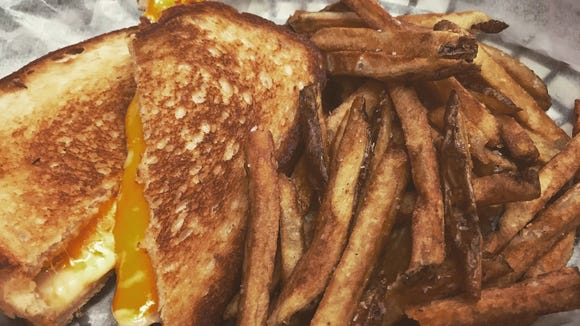 Grilled cheese cozies up to french fries at Steve's Grilled Cheese & Quesadilla Company. .