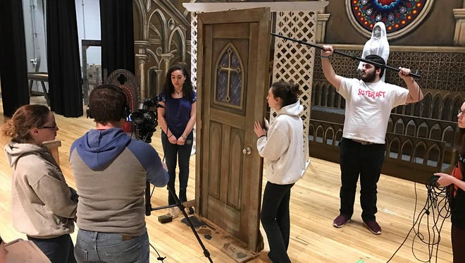 """From left, students Julie Steckel, David Altschul at the camera, Maya Gelsi, Danielle DiPietro, and Alex Costa holding the microphone work on a film for the Cedar Grove High School """"Best of the Fest"""" show debuting May 5, 2017."""