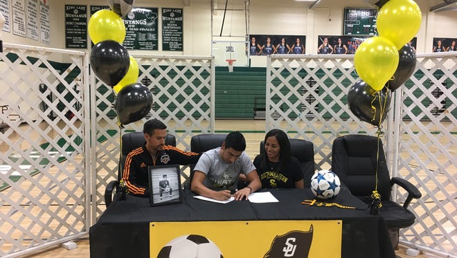 Christian Torres signed to play soccer with Southwestern University on Friday.